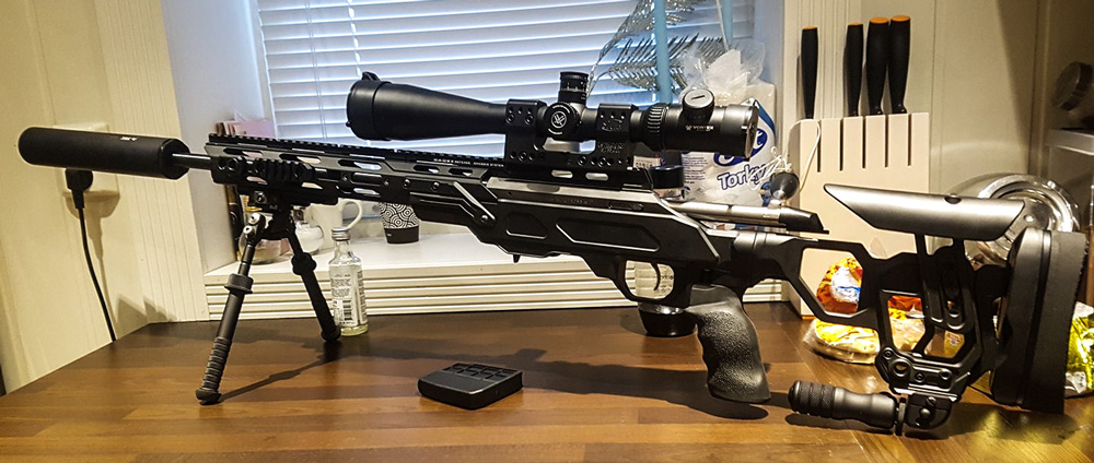 Field Tactical housing a Tikka T3x with a A-tec suppressor